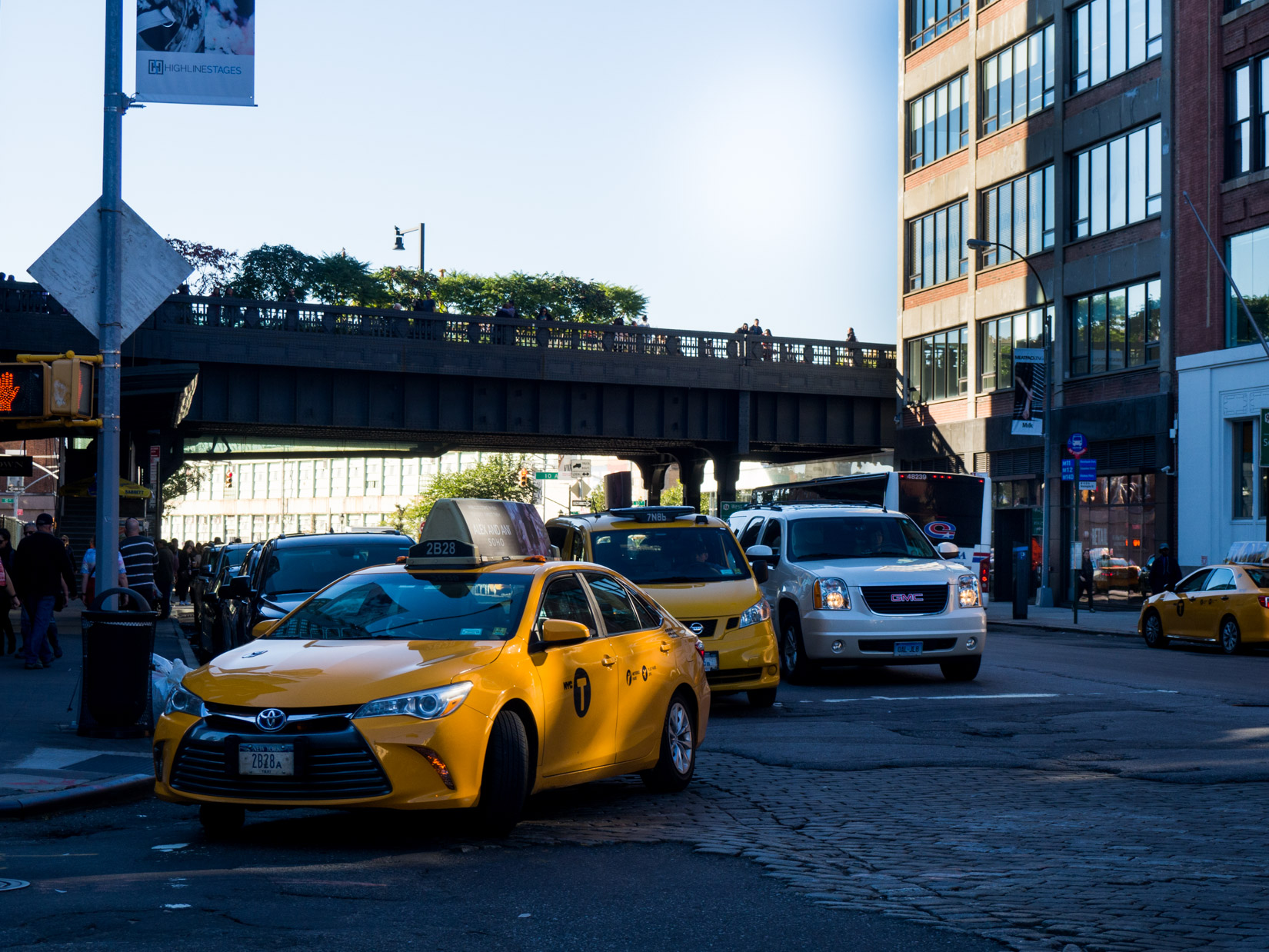 City Buildings and Street with Taxi