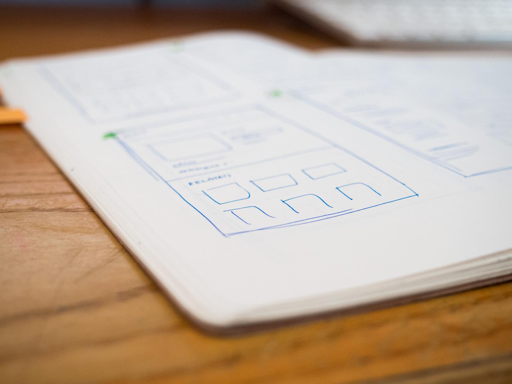 Open Sketchbook on Desk