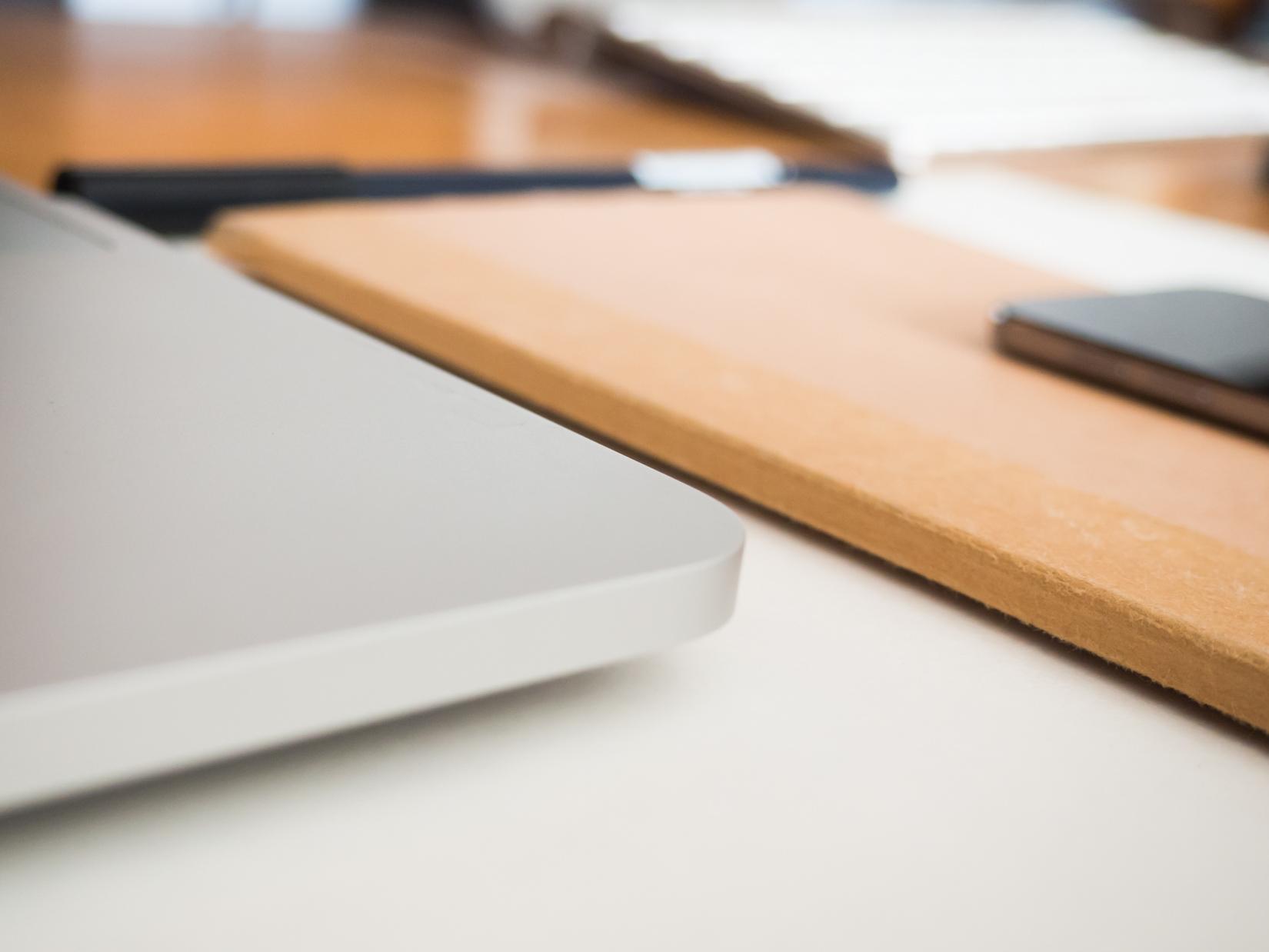 Desk with Sketchbook and Laptop
