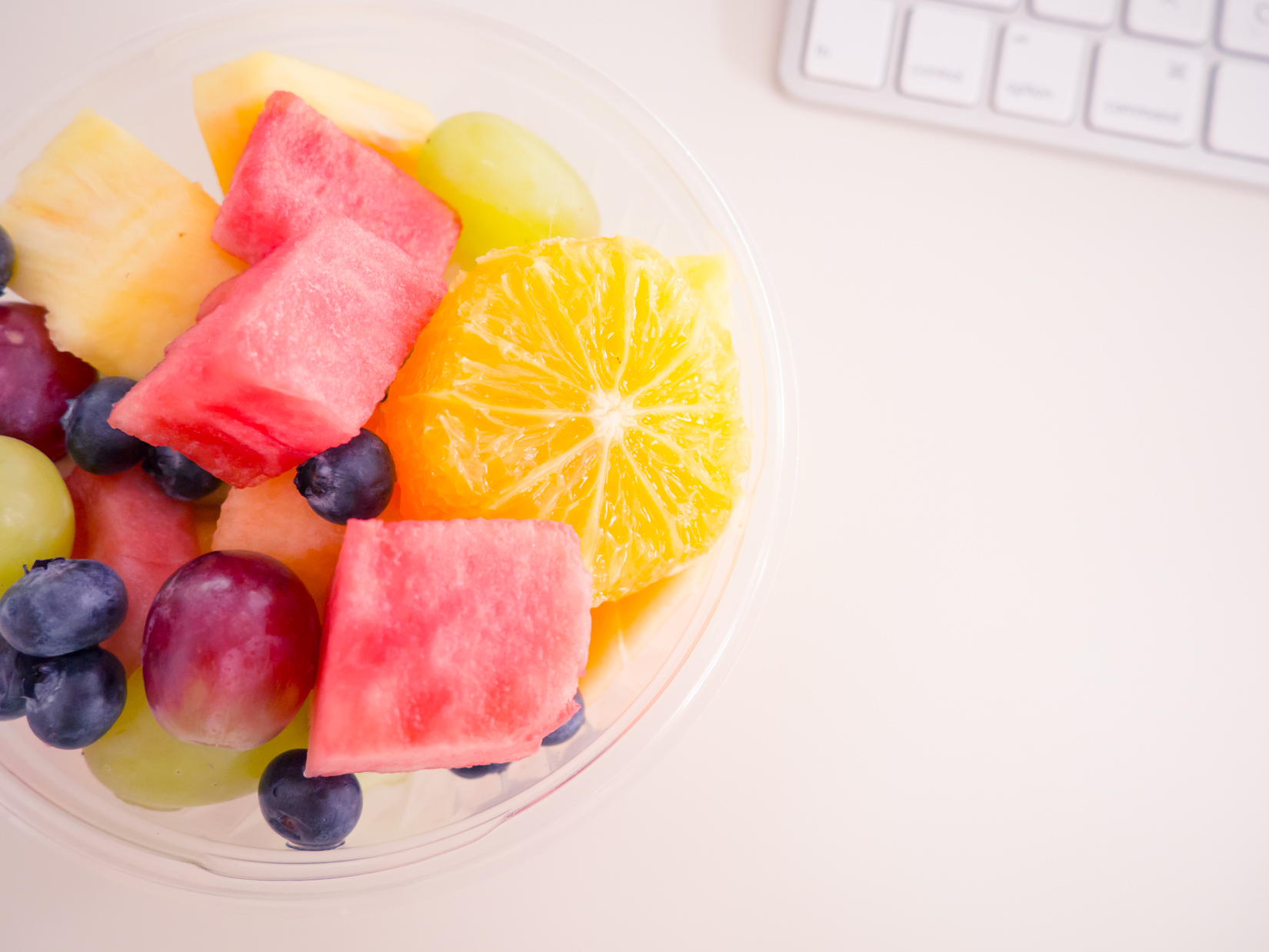 Fruit in Cup on Desk