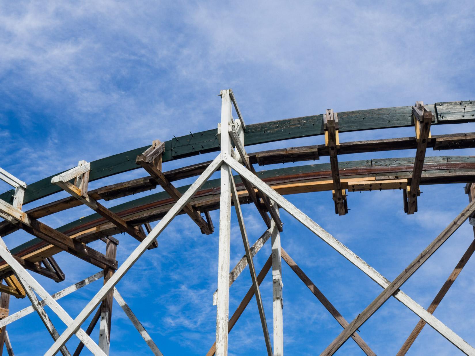 Wooden Rollercoaster Tracks Under Blue Sky