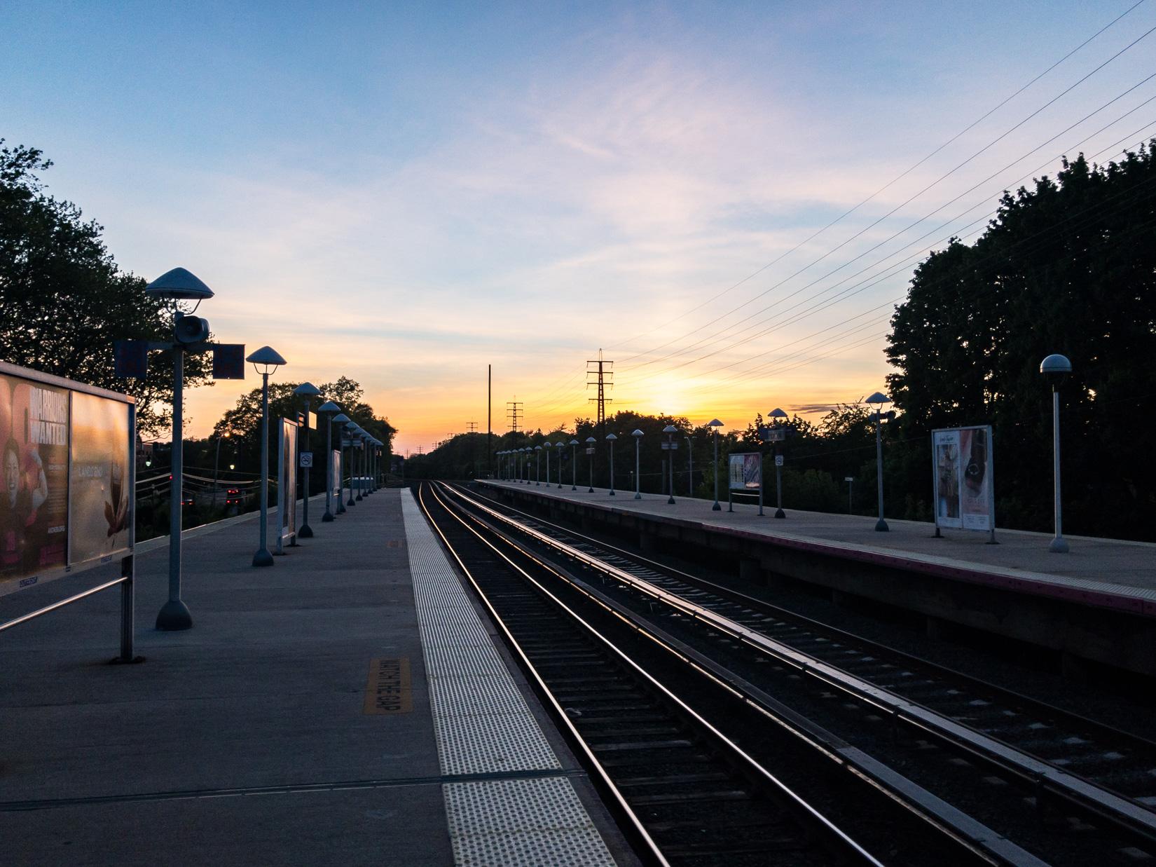 Sunset Over Train Platform and Tracks