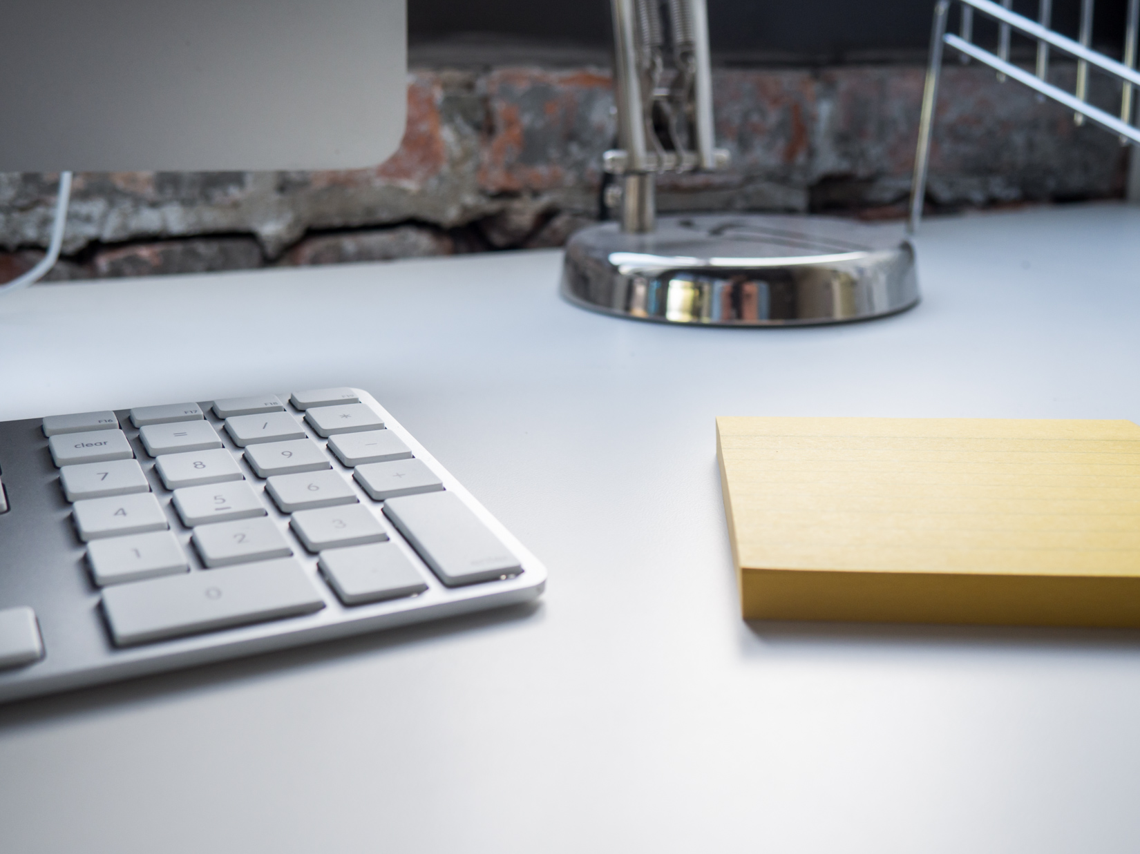 Office Desk with Keyboard and Notepad