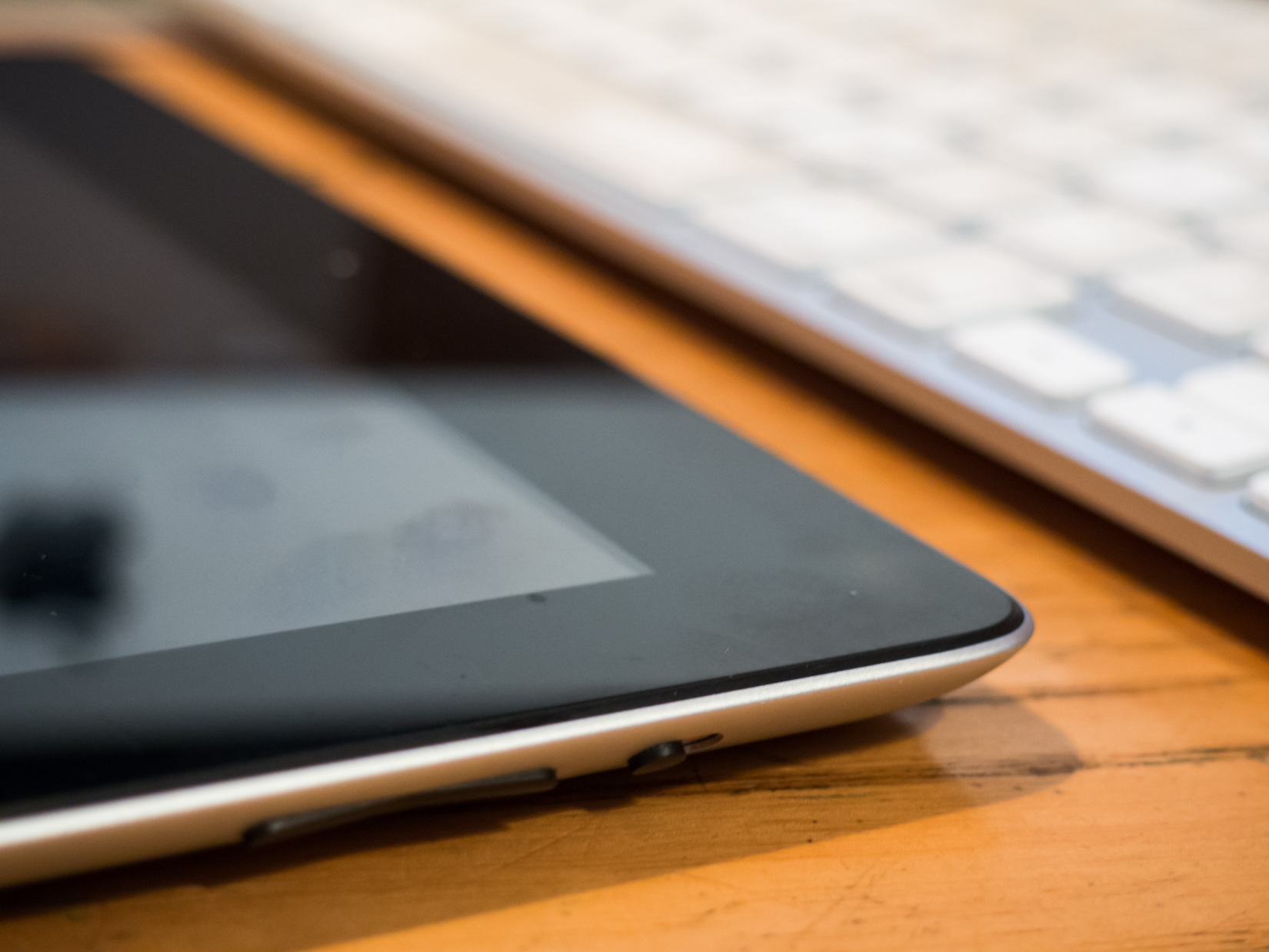 Tablet and Keyboard on Wooden Desk