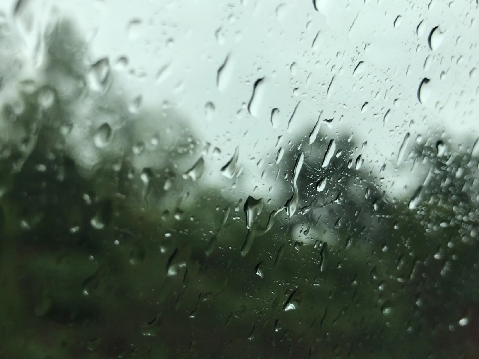 Raindrops Falling on Moving Car Window