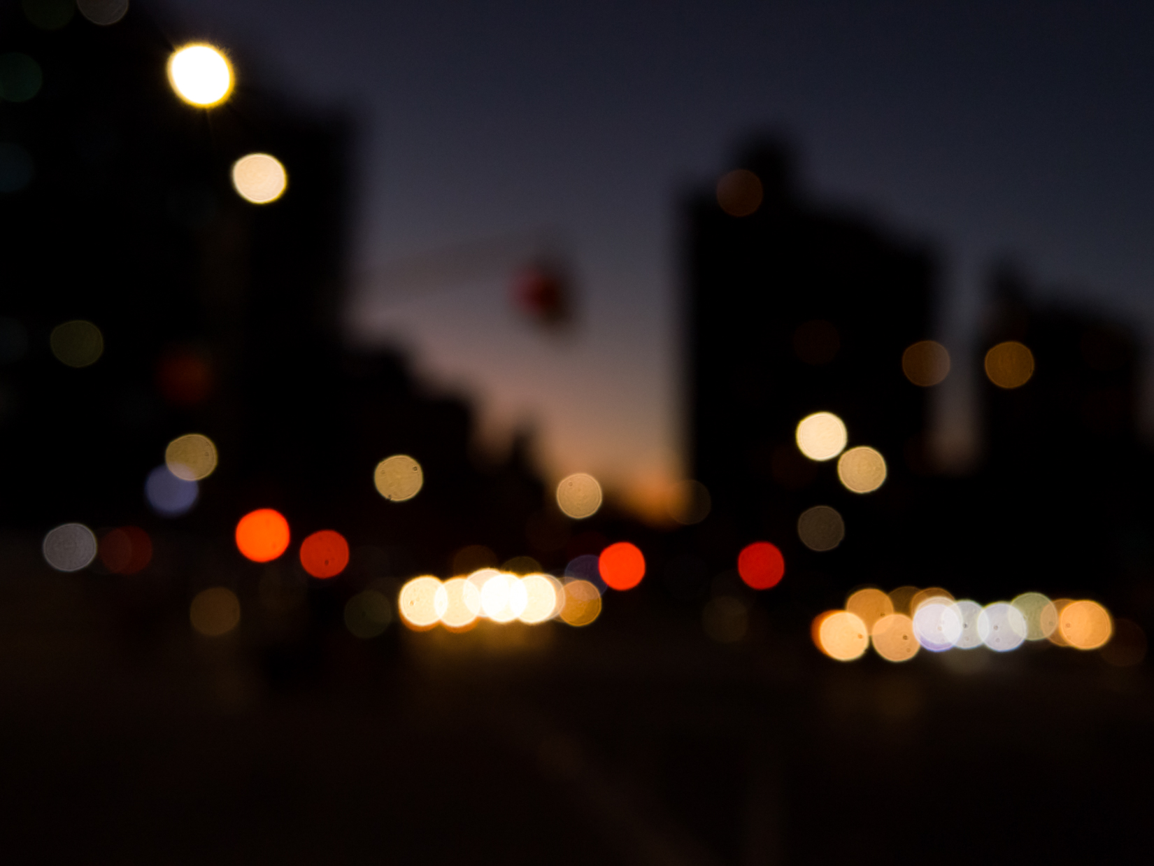 Blurred City Street at Sunset